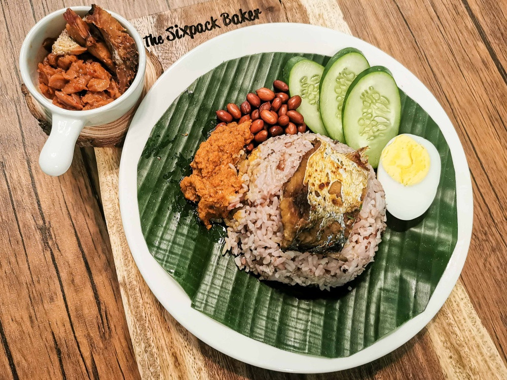 Sabahan style nasi lemak with kinoing or salted fish, sambal takob akob and usual nasi lemak toppings. However, rice cooked in coconut milk is not quite borrowed. Kadazan have traditionally cooked rice in the same manner and called it vinoigan. Photo: The Sixpack Baker